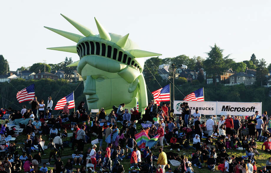Thousands of people gather during Family 4th festivities at Gas Works Park in Seattle on Wednesday, July 4, 2012. The 21-minute fireworks show costs $150,000 to produce. Photo: LINDSEY WASSON / SEATTLEPI.COM