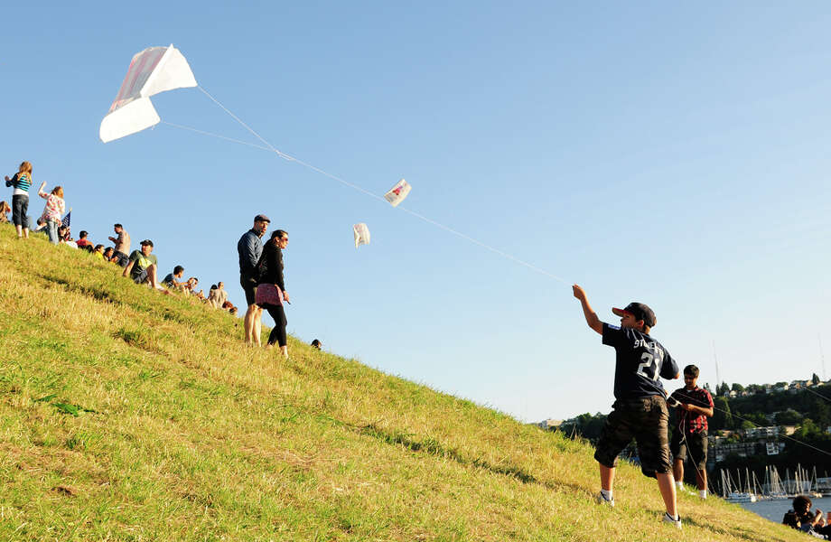 Good weather at last meant this young boy could fly a kite on the back side of Kite Hill during Family 4th festivities at Gas Works Park in Seattle on Wednesday. Photo: LINDSEY WASSON / SEATTLEPI.COM