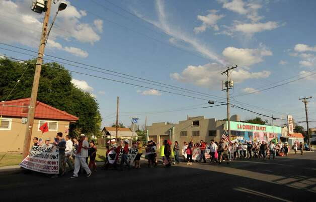 People in the March for Immigrant Rights walk along Brazos Street on Wednesday, July 4, 2012. Photo: Billy Calzada, San Antonio Express-News / © 2012 San Antonio Express-News