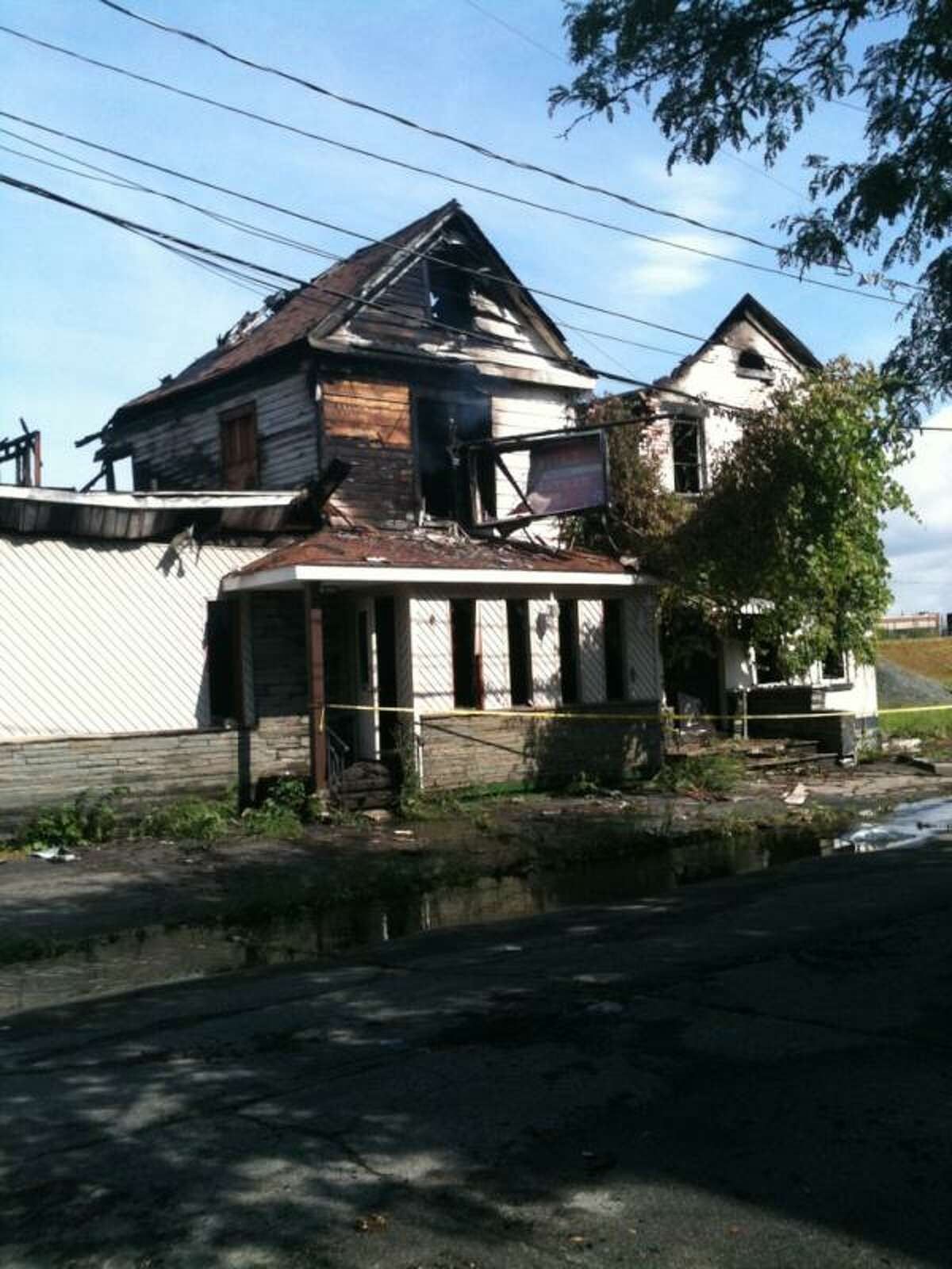 This is what remains after fire tore through the former Luigi's Restaurant on Barrett Street in Schenectady on Thursday, July 5, 2012. (Matthew Hamilton / Times Union)