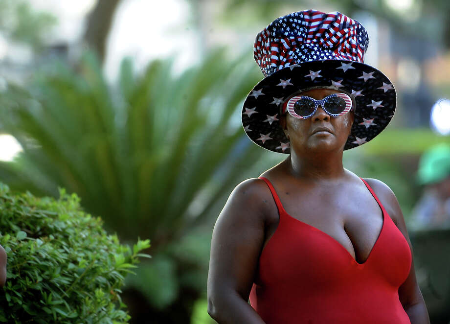 Felicia Johnson watches the entertainment during the Independence Day celebration downtown Beaumont, Wednesday, July 4, 2012. Tammy McKinley/The Enterprise Photo: TAMMY MCKINLEY