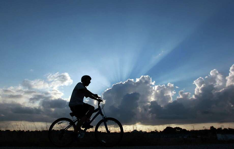Cyclist, Mike Hallecook rides his bike along Barker Reservoir in George Bush Park where he said he rides two-to-three times a week Thursday, July 5, 2012, in Houston. 
