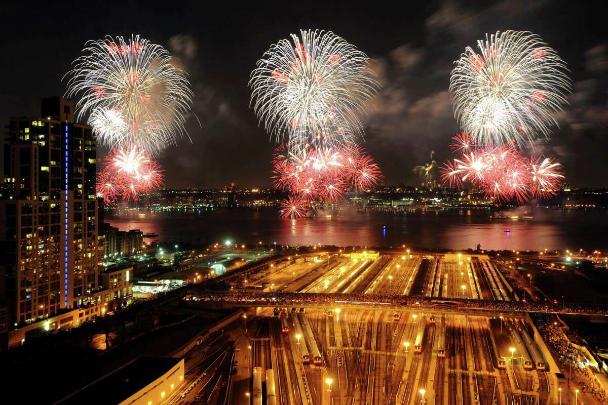 Fireworks light up the sky during the annual Macy's Fourth of July fireworks display over the Hudson River as seen from New York, Wednesday, July 4, 2012.