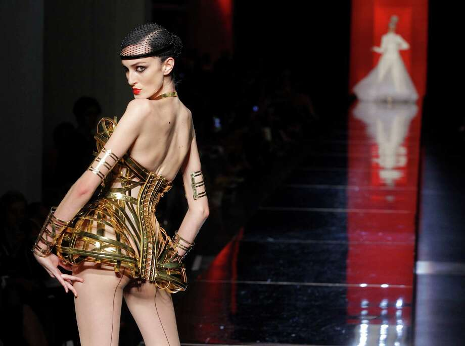 A model wears a creation by French designer Jean Paul Gaultier as part of his presentation for Women's Fall Winter 2012-2013 haute couture fashion collection in Paris, France, Wednesday July 4, 2012. Photo: Jacques Brinon, AP / AP