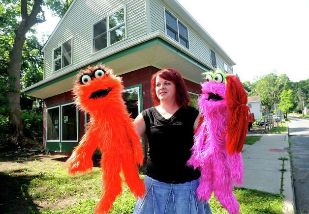 Wendy Mitchell holds Harry, left, and Molly, puppets from the new theater arts program she will offer when renovations are completed on Studio 10 Center for the Arts LLC, in Bethel. Photographed Thursday, July 5, 2012. Photo: Michael Duffy / The News-Times