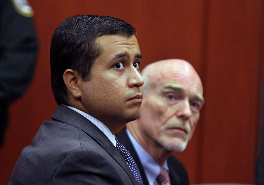 George Zimmerman, left, and attorney Don West appear before Circuit Judge Kenneth R. Lester, Jr.  Friday, June 29, 2012, during a bond hearing at the Seminole County Criminal Justice Center in Sanford, Fla.  Zimmerman is charged with second-degree murder in the shooting of Trayvon Martin.(AP Photo/Orlando Sentinel, Joe Burbank, Pool) Photo: Joe Burbank, MBO