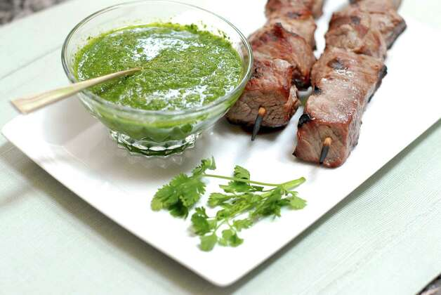 Pebre sauce melds the flavors of fresh cilantro, parsley and oregano for a colorful condiment that goes well with beef. Ronnie Fein creates condiments with parsley, cilantro and other herbs in Stamford, Conn. on Friday June 22, 2012. Photo: Dru Nadler / Stamford Advocate Freelance
