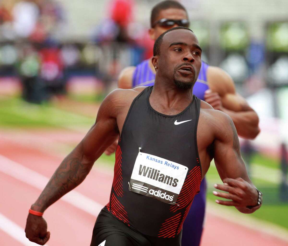 Ivory Williams, running unattached, looks to the clock after crossing the finish line in the men's invitational 100 meter dash during the Kansas Relays athletics meet, Saturday, April 23, 2011, in Lawrence, Kan. Williams won the race with a time of 10.05. (AP Photo/Orlin Wagner)