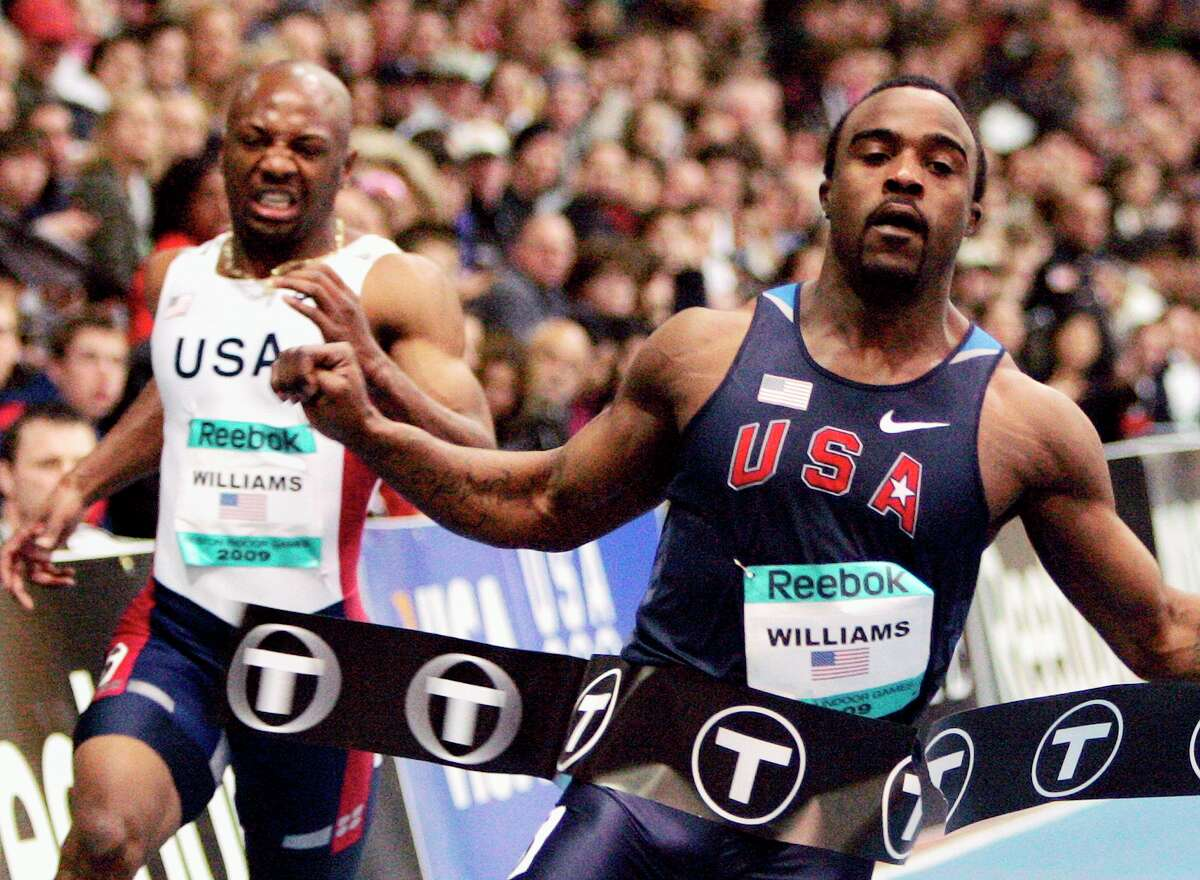 Ivory Williams, right, breaks the tape ahead of second-place finisher Rubin Williams to win the men's 200-meter dash at the Boston Indoor Games athletics competition, Saturday, Feb. 7, 2009, in Boston. (AP Photo/Michael Dwyer)