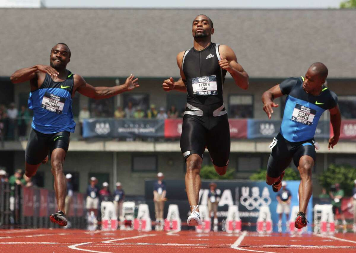 Tyson Gay, center, races against Ivory Williams, left, and Rodney Martin in the men's 100 meter semifinals at the U.S. Olympic Track and Field Trials in Eugene, Ore., Sunday, June 29, 2008. (AP Photo/Eric Gay)