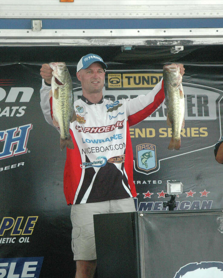 Todd Driscoll shows off his fish that clenched him the win and the check Photo: Jodie Warner