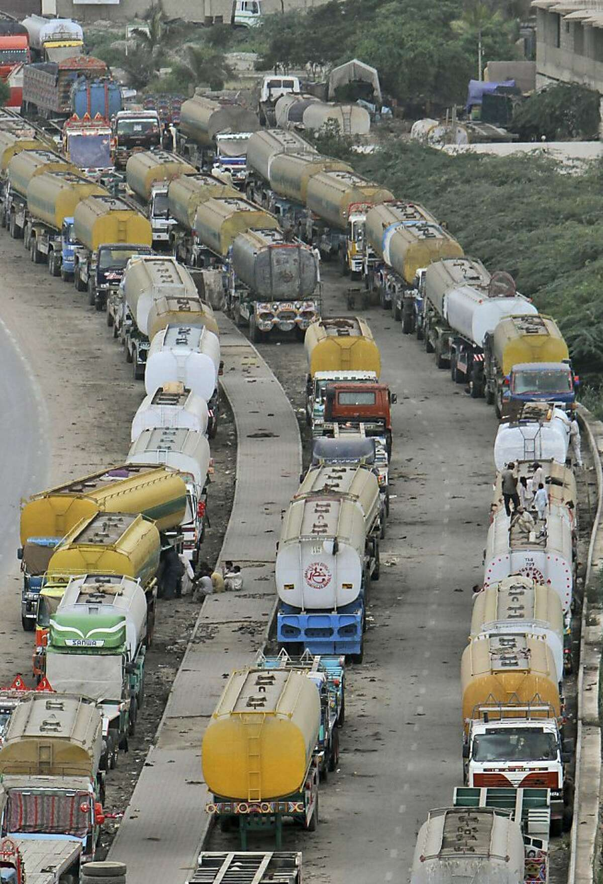 Oil tankers, which were used to transport NATO fuel supplies to Afghanistan, are parked Karachi, Pakistan, Wednesday, July 4, 2012. Trucks carrying NATO troop supplies are set to resume shipments to Afghanistan on Wednesday following a deal between the U.S. and Pakistan that ended Islamabad's seven-month blockade. (AP Photo/Fareed Khan)
