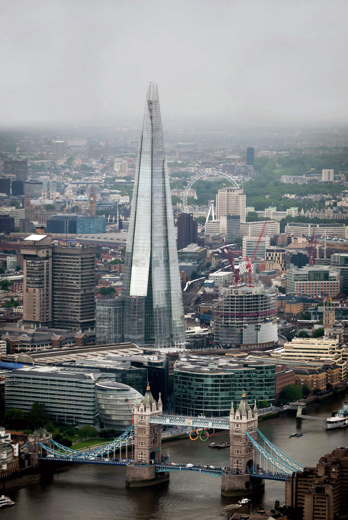 This aerial photo made available by Newscast shows The Shard, center, a newly-constructed high-rise building in London, that is western Europe's tallest, ahead of the official opening on Thursday. The Shard is 309.6 meters tall (1,016 feet) and features high quality offices, a 5-star hotel with more than 200 rooms and suites and three floors of restaurants. It will also feature exclusive super prime residential apartments and the top levels will consist of the capital's highest public viewing gallery offering 360-degree views of London. (AP Photo/Newscast, Ben Fitzpatrick)