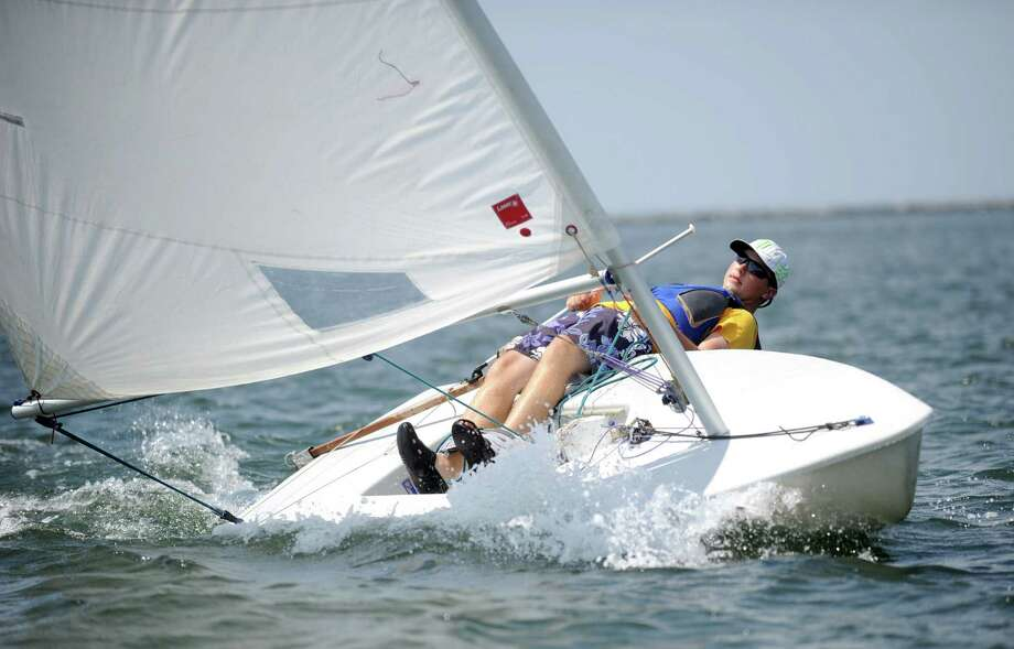 Casper Wasnieski practices sailing in the Long Island Sound with Young Mariners in Stamford on Thursday, July 5, 2012. Photo: Lindsay Niegelberg / Stamford Advocate
