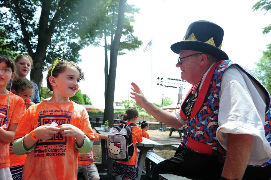 Eight-year-old Channa Eisenbach, of Litchfield, talks with Joe Barney, of Bridgeport, dressed as P.T. Barnum, during P.T. Barnum's 202th birthday party at Beardsley Zoo Thursday, July 5, 2012. Photo: Autumn Driscoll / Connecticut Post
