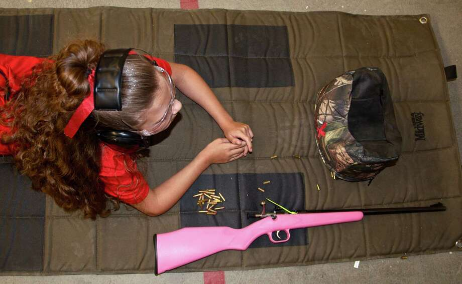 Kaitlin Del Re, 8, studies her target at Best Shot Camp in Friendswood. Photo: Pete Holley