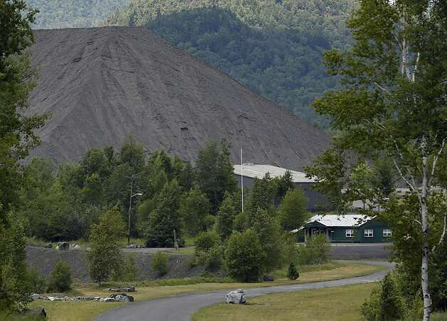 In this July 3, 2012 photo, a rock pile is seen at the Tahawus mine in Newcomb, N.Y. A railroad company is renovating rusty, overgrown tracks to get at millions of tons of waste rock at the abandoned iron and titanium mine near the source of the Hudson River and the highest peaks of the Adirondacks. The federal Surface Transportation Board on June 14, 2012, cleared the way for the New York freight line to be operated by the Saratoga and North Creek Railway. The planned reopening of a 30-mile rail link is part of a widespread resurgence of short line and regional railroads driven by high oil prices that make rail shipping more economical than trucking. (AP Photo/Mike Groll) Photo: Mike Groll, Associated Press / SF