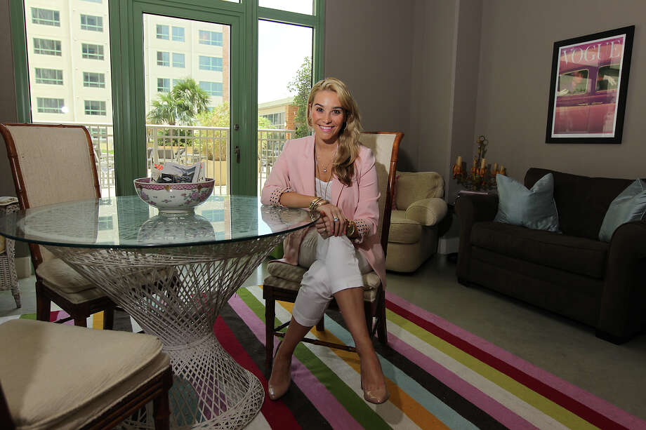 Ellie Leeper, Director of Young Professionals Relations for Downtown Alliance San Antonio has her portrait taken in her studio apartment at Vistana Apartments on Tuesday, July 3, 2012. Leeper enjoys the downtown location of her apartment and encourages many of the city's young professionals to consider living in downtown. Photo: Kin Man Hui, SAN ANTONIO EXPRESS-NEWS / ©2012 SAN ANTONIO EXPRESS-NEWS