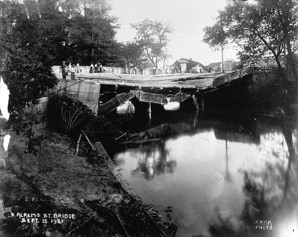 Thirteen of the city's twenty-seven bridges were destroyed in the flood that swept San Antonio on September 9-10, 1921.  The flood acted as the impetus for flood control measures and river improvements that culminated in Robert H.H. Hugman's San Antonio River Walk.    Alamo bridge (RABA COLLECTION) Photo: Ernst Wilhelm Raba, Courtesy Photo / San Antonio Conservation Society