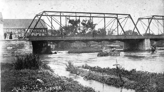 A thirsty horse takes a drink beneath the Navarro Bridge in this 1891 photo. (RABA COLLECTION) Photo: Ernst Wilhelm Raba, Courtesy Photo / San Antonio Conservation Society