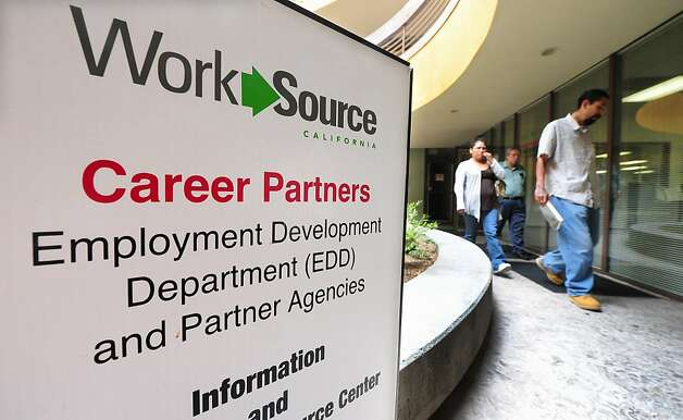 (FILES)People walk past a sign leading to a job center in Rosemead, east of downtown of Los Angeles in the San Gabriel Valley in this May 24, 2012 file photo in California.   New claims for US unemployment benefits fell last week after rising for four straight weeks, the government said June 7, 2012 in a report that offered a ray of hope for the troubled labor market. The Labor Department reported 377,000 jobless claims were filed in the week ending June 2, three percent fewer than the prior week and slightly higher than analysts expected. The four-week moving average, which helps to smoothe week-to-week volatility, also fell, by 1,750 to 377,750 new claims. AFP PHOTO / Frederic J. BROWNFREDERIC J. BROWN/AFP/GettyImages Photo: Frederic J. Brown, AFP/Getty Images