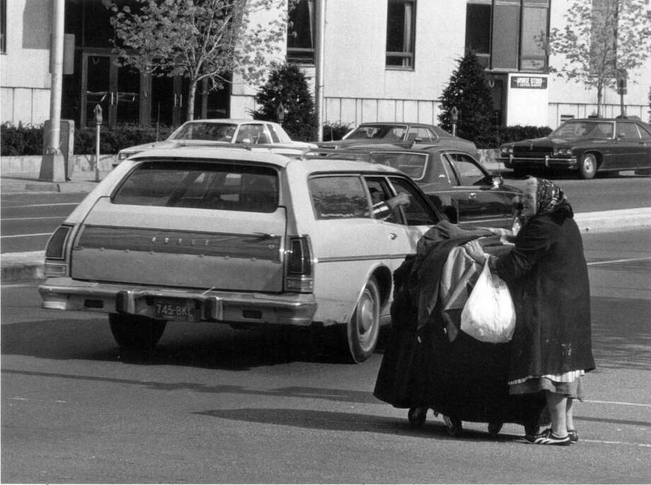 Maria Hrycewicz, a downtown fixture, died 25 years ago. In this 1984 photo she is crossing Washington Street. Photo: File Photo