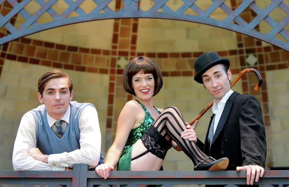 """Jacob A. Ware as Clifford Bradshaw, left, Shannon Rafferty as Sally Bowles, center, and Jason Jacoby as the Master of Ceremonies pose on the Park Playhouse set of """"Caberet"""" on Friday, June 29, 2012, at Washington Park in Albany, N.Y. (Cindy Schultz / Times Union) Photo: Cindy Schultz / 00018230A"""