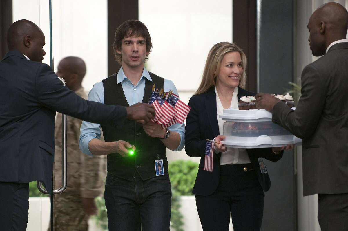 Christopher Gorham, left, as Auggie Anderson and Piper Perabo as Annie Walker in