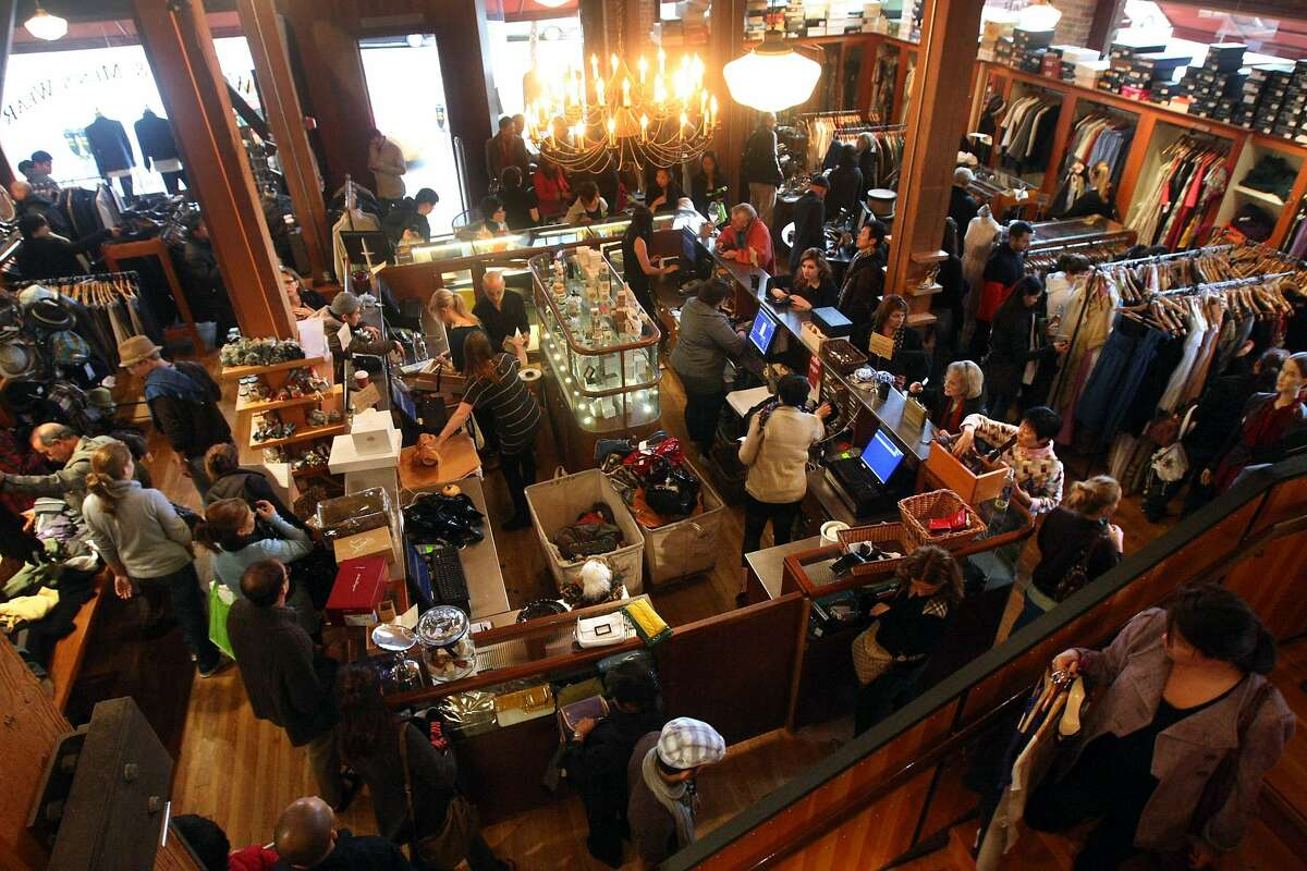 Shoppers look through merchandise at Jeremy's department store in San Francisco Friday morning, November 27, 2009.
