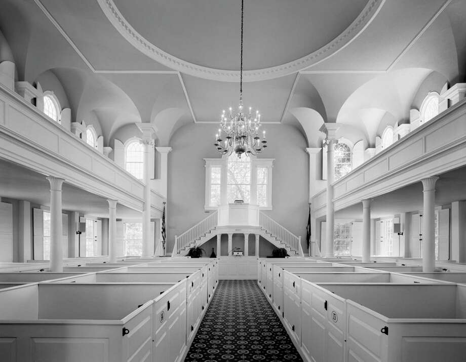 "An image of Old First Church in Old Bennington, Vt. is on view in ""White on White: Churches of Rural New England,"" an exhibition featuring the work of Steve Rosenthal at the Bruce Museum in Greenwich. Photo: Contributed Photo"