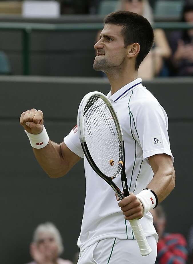 Novak Djokovic of Serbia reacts as he wins against Florian Mayer of Germany during a quarterfinals match at the All England Lawn Tennis Championships at Wimbledon, England, Wednesday, July 4, 2012. (AP Photo/Kirsty Wigglesworth) Photo: Kirsty Wigglesworth, Associated Press