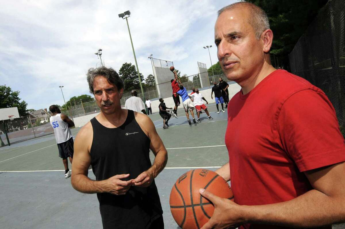 """Basil Anastassiou, left, and Paul Kentoffio have made a documentary called """"Ballin' at the Graveyard"""" about the 40-year-old game of pickup basketball played every weekend on the courts at Washington Park in Albany N.Y. Saturday June 30, 2012. (Michael P. Farrell/Times Union)"""