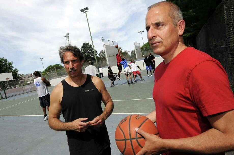 "Basil Anastassiou, left, and Paul Kentoffio have made a documentary called ""Ballin' at the Graveyard"" about the 40-year-old game of pickup basketball played every weekend on the courts at Washington Park in Albany N.Y. Saturday June 30, 2012. (Michael P. Farrell/Times Union) Photo: Michael P. Farrell"