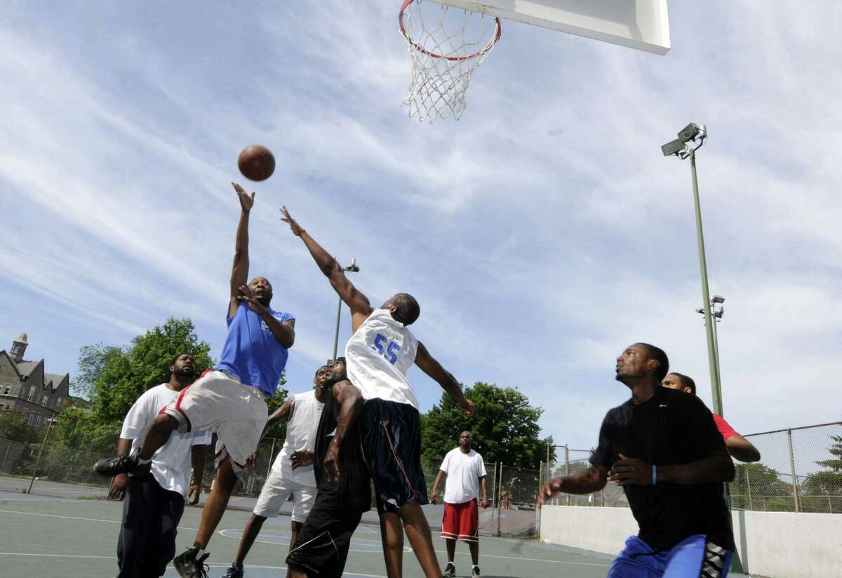 A game of pickup basketball played every weekend on the courts at Washington Park in Albany N.Y. Saturday June 30, 2012. (Michael P. Farrell/Times Union)