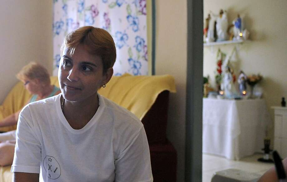 Rita Coccaro, 41, a medium of the Umbanda religion that traces its origins to Brazil, speaks about her experience with the religion in her home in Rio de Janeiro, Brazil. Umbanda is a religion that originated with Brazilian slaves from Africa. It combines their African religions with Catholicism and spiritism.(Chloe Elmer/Penn State University/MCT) Photo: Chloe Elmer, McClatchy-Tribune News Service