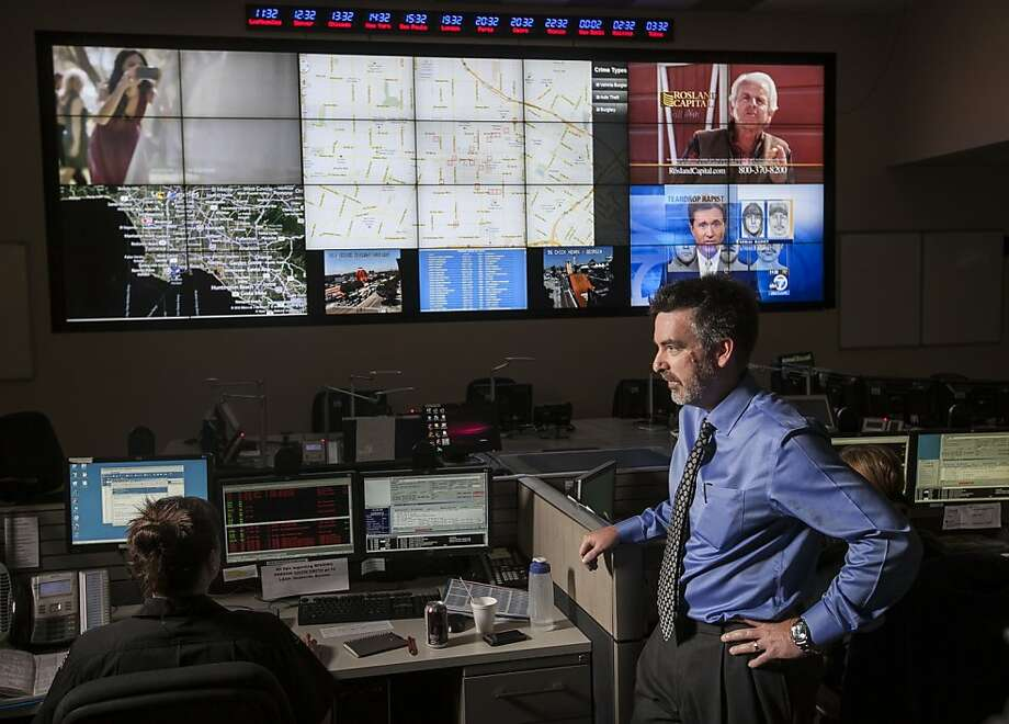 "In this photo taken Friday, June 29, 2012, Jeff Brantingham, anthropology professor at the University of California Los Angeles,  displays a computer generated ""predictive policing,"" zones at the Los Angeles Police Department  Unified Command Post (UCP) in Los Angeles. Police officials say they are having success with a computer algorithm model that helps determine where to send officers to prevent or possibily interrupt a crime, which may serve as a model for other cash-strapped law enforcement agencies. (AP Photo/Damian Dovarganes) Photo: Damian Dovarganes, Associated Press"