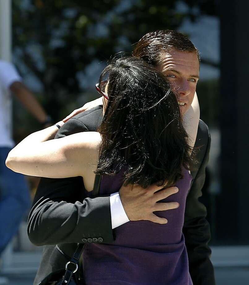 William Lynch is hugged by family friend Bonnie Rose outside the Hall of Justice during a lunch break for the jury deliberating in his trial in San Jose, Calif. on Thursday, July 5, 2012. Lynch is accused of assaulting Jerry Lindner, a priest who Lynch says sexually molested him as a boy. Photo: Paul Chinn, The Chronicle