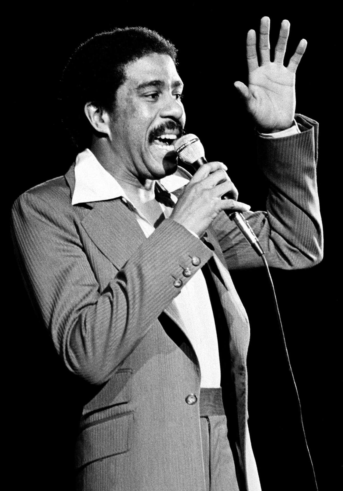 ** FILE ** Comedian-actor Richard Pryor is shown as he performs in 1977. Pryor, the caustic yet perceptive actor-comedian who lived dangerously close to the edge both on stage and off, has died, his ex-wife said Saturday, Dec. 10, 2005. He was 65. Pryor died of a heart attack at his home in the San Fernando Valley sometime late Friday or early Saturday, Flyn Pryor said. (AP Photo, File) Ran on: 12-11-2005 Richard Pryor talked bluntly and worked his own ordeals into his comedy. ALSO Ran on: 12-14-2005 Richard Pryor made one of his final appearances as a stand-up comedian at the Circle Star Theater in San Carlos in 1992.