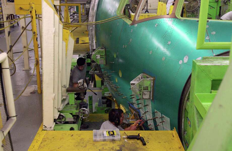 Boeing 777 production is shown on June 13, 2012 in Boeing's wide-body plant in Everett, Wash. Everett is convenient for Asian suppliers, and has the only workforce experienced in building 777s, the most relevant infrastructure, state government support and the least risk, according to Aboulafia. Photo: Aubrey Cohen, Seattlepi.com Staff