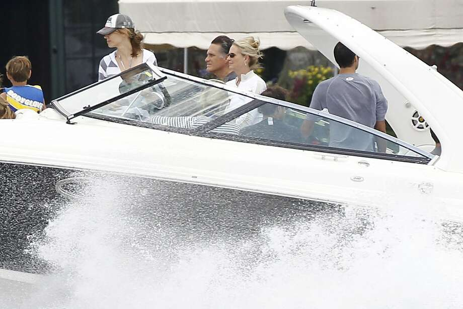 Republican presidential candidate Mitt Romney drives his boat with his famiy on Lake Winnipesaukee in Wolfeboro, N.H., Thursday, July 5, 2012, as he continues his vacation off the campaign trail. (AP Photo/Charles Dharapak) Photo: Charles Dharapak, Associated Press