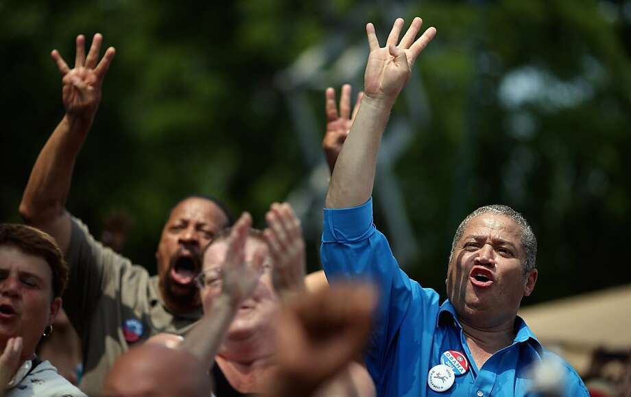 MAUMEE, OH - JULY 05: Supporters shout ''Four more years!'' as U.S. President Barack Obama speaks at a campaign event at the Wolcott House Museum Complex July 5, 2012 in Maumee, Ohio. Obama is traveling by bus through Northern Ohio and Western Pennsylvania for a ''Betting on America'' campaign tour. The president highlighted his administration's efforts to improve the economy by creating manufacturing jobs and rescuing the American auto industry and also taking swings at the presumptive Republican presidential nominee, former Massachusetts Gov. Mitt Romney. (Photo by Chip Somodevilla/Getty Images) Photo: Chip Somodevilla, Getty Images