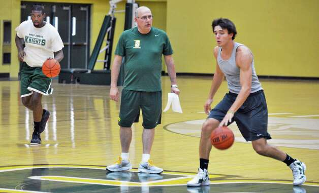 Siena head coach  Mitch Buonaguro with players Marcus Hopper, left, and Brett Bisping, at right, during men's basketball practice at the college Tuesday July 3, 2012.  A new NCAA rule change allows college basketball teams to practice during the summer.  (John Carl D'Annibale / Times Union) Photo: John Carl D'Annibale / 00018339A