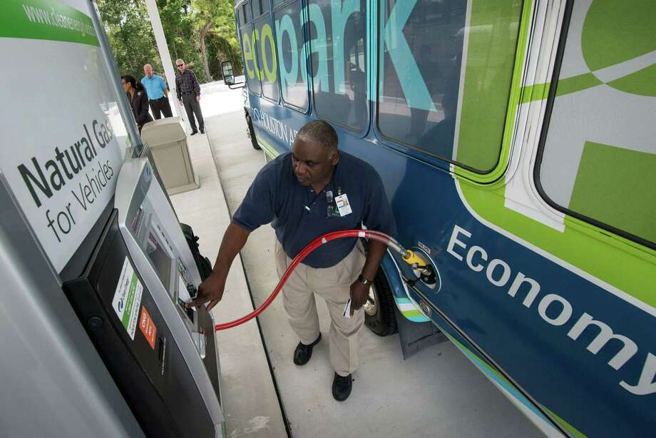 Parking shuttle bus operator Harvey Davis Sr. stops for fuel at a compressed natural gas station  near Bush Intercontinental Airport. The Houston Airport System fleet of 30 parking shuttles at the airport started using the station last month. Photo: Smiley N. Pool / © 2012  Houston Chronicle