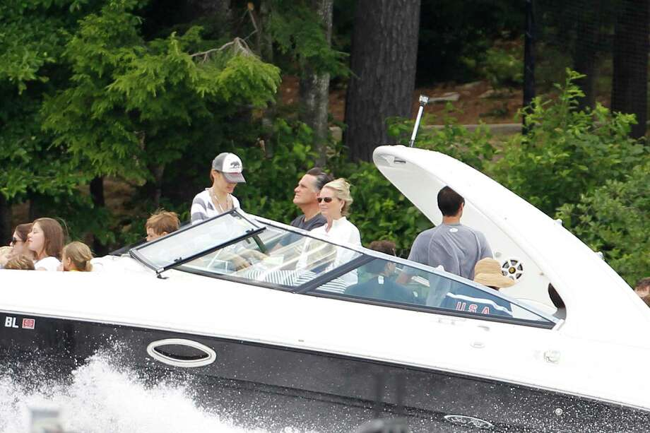 Republican presidential candidate Mitt Romney takes his  boat out Thursday on Lake Winnipesaukee in Wolfeboro, N.H. Photo: Charles Dharapak / AP