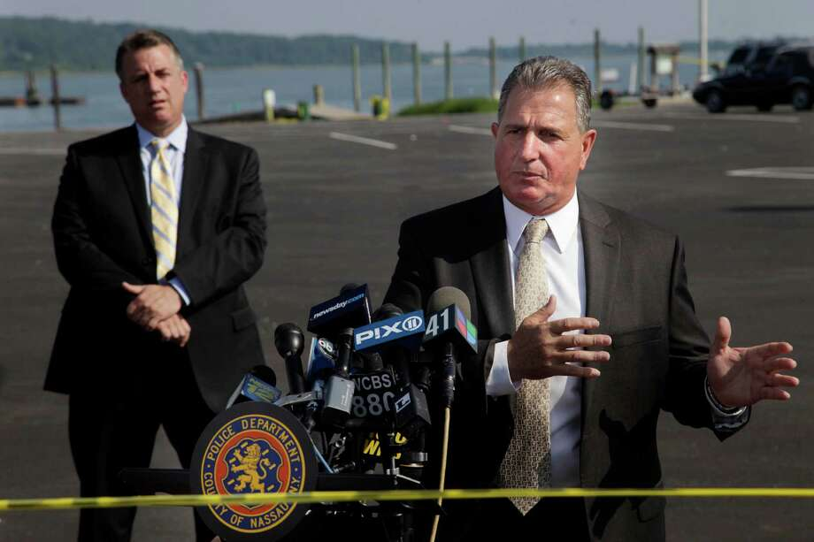 Nassau County Police Det. Lt. John Azzata, right, gives information about a fatal boating accident during a news conference in Oyster Bay, N.Y., Thursday, July 5, 2012.  Police say three bodies have been pulled out of New York's Long Island Sound after a yacht capsized on the Fourth of July  Police say three bodies pulled out of New York's Long Island Sound after a yacht capsized were all children. The bodies of the 12-year-old boy and two girls, ages 11 and 8, were recovered from the boat's cabin. Twenty-four other people were rescued, and were treated and released. (AP Photo/Seth Wenig) Photo: Seth Wenig, Seth Wenig/Associated Press / AP