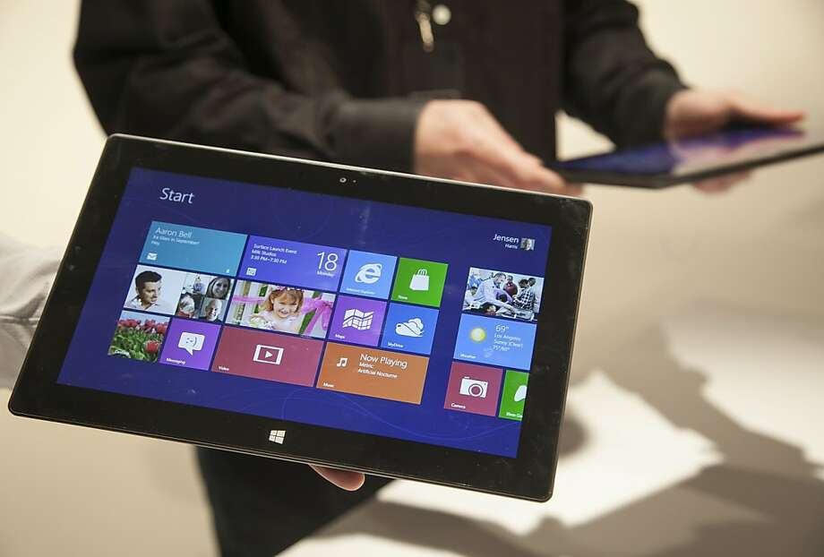 Microsoft Corp.'s Surface tablet computers, aiming to compete with Apple's iPad, are displayed at Hollywood's Milk Studios in Los Angeles Monday, June 18, 2012. The 9.3-millimeter thick tablet comes with a kickstand to hold it upright and keyboard that is part of the device's cover. (AP Photo/Damian Dovarganes) Photo: Damian Dovarganes, Associated Press