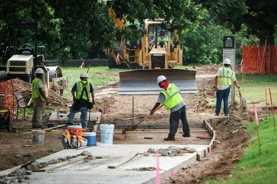 A crew overseen by the Texas Department of Transportation is already replacing the main hike-and-bike trail through Buffalo Bayou Park, including the 4.6-mile Sandy Reed Memorial Trail near the Rosemont Bridge over the bayou. Photo: Michael Paulsen / © 2012 Houston Chronicle
