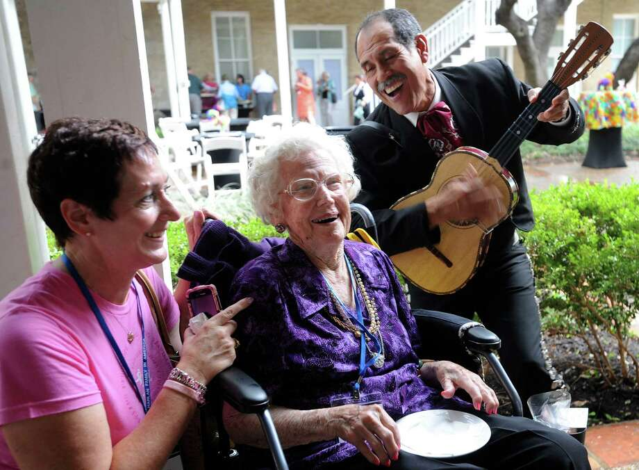 Grace Harlan Bristol, who is 99 years old, and her granddaughter, Elizabeth Parks, enjoy Jesus Magallanes and the Mariachi Los Gallos de Jalisco during the  Harlan Family Reunion at the Marriott Plaza Hotel on July 5, 2012. The original Harlans were Quakers and came to Americas in search of religious freedom.  They arrived at William Penn's Colony at New Castle, Delaware, in 1687, according to the family website. Photo: BILLY CALZADA, San Antonio Express-News / © 2012 San Antonio Express-News