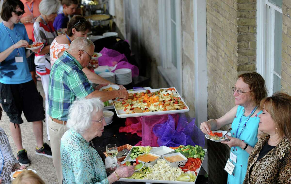 People at the Harlan family reunion enjoy food at the Marriott Plaza Hotel on July 5, 2012. The original Harlans were Quakers and came to Americas in search of religious freedom. They arrived at William Penn's Colony at New Castle, Delaware, in 1687, according to the family website.