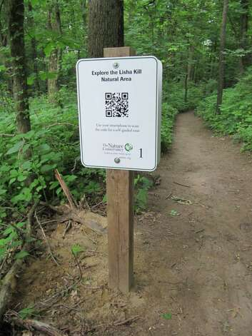 Photo by Gillian Scott Signs with QR codes are part of the Nature Conservancy's new audio tour at the Lisha Kill Natural Area in Niskayuna.